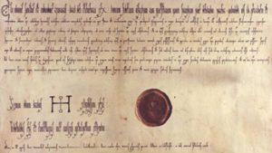 """Odenses """"dåbsattest"""", eller rettere en rekonstruktion, fremstillet ved 1000-års jubilæet i 1988. Det originale brev er for længst gået tabt. Rekonstrueret af Else Marie Frandsen for Mammens Bogtrykkeri, Scanner Team og Odense Bys Museer."""